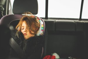 child on long road trip in a car